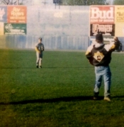 Leonard playing catch on a pro baseball field